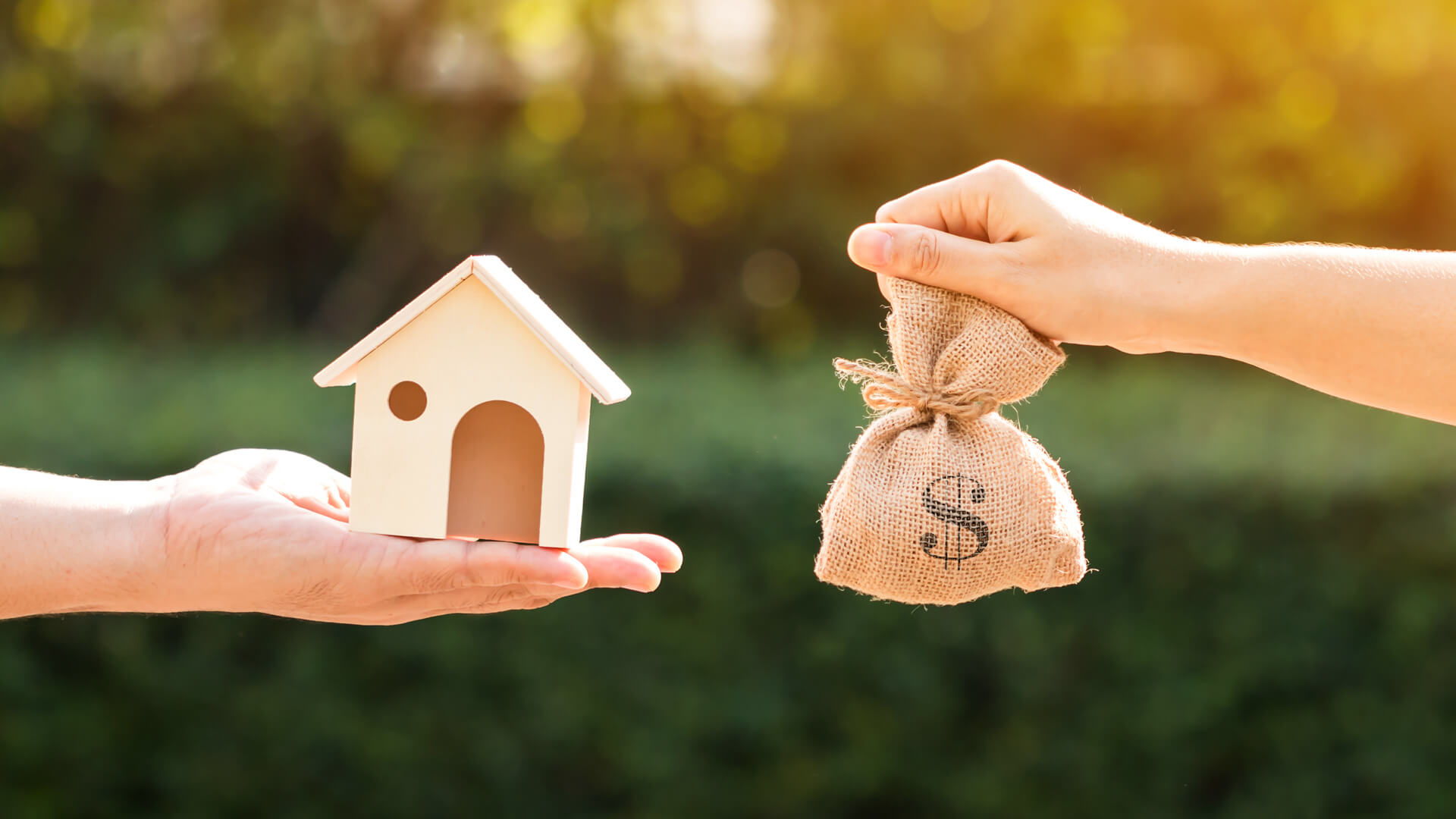 Wooden-home-and-a-bag-of-money-shutterstock_518887963